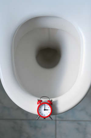Toilet bowl and clock. Prostate concept