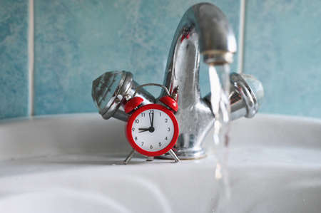 Water tap and clock. Water saving concept