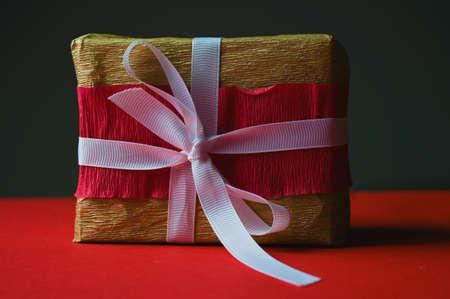 gift box with white ribbon on dark background
