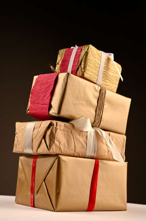 a stack of holiday gifts, side view