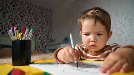 Kiev, Ukraine- March 10, 2020: the child draws independently at the table