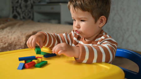 the child develops motor skills with geometric shapes