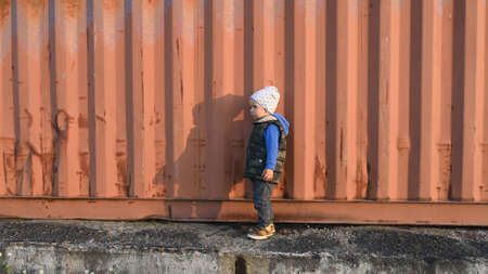 a child near a shipping container