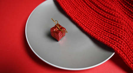 a gift on a plate with a sweater. High quality photo