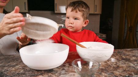 Strain the dough through a colander. High quality photo