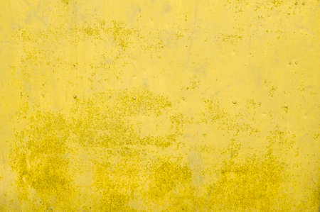 Leaked paint of yellow old metal. High quality photo