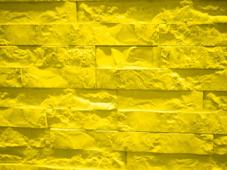 Background from a yellow brick wall. presentation of fashion colors 2021. High quality photo