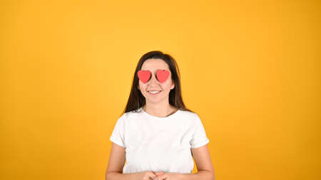 Woman blinded by love, on a yellow background. High quality photo