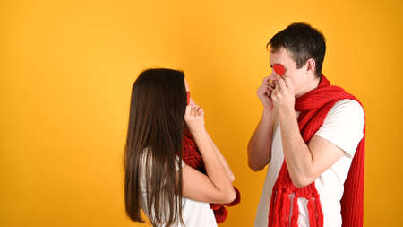 Blinded by love couple, on a yellow background. High quality photo