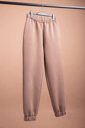 Brown sweatpants. hanging on a hangernts. High quality photo