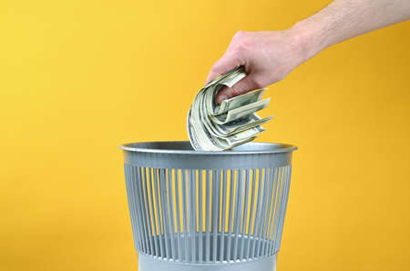 Money is thrown into the trash. High quality photo Archivio Fotografico