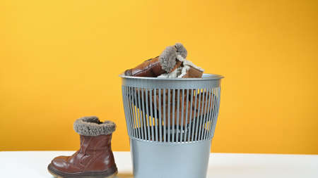 Throw childrens shoes in the trash bin