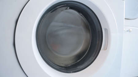 rotating drum washing machine, close up Foto de archivo