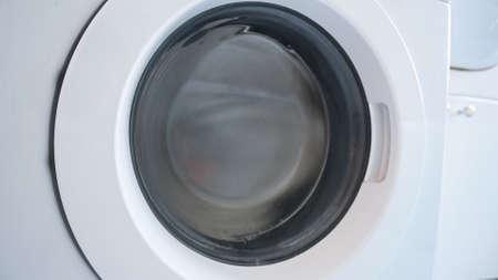 rotating drum washing machine, close up