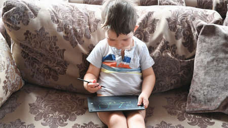 Child 2-3 years old draws on a tablet