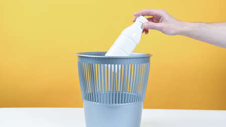 Plastic milk bottle throws in the trash. High quality photo