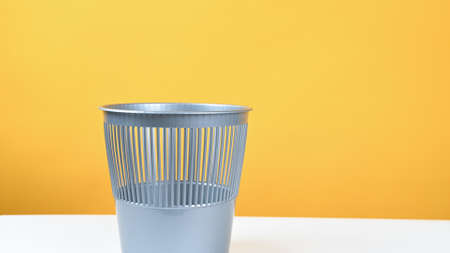 trash can for waste, on a yellow background. High quality photo 版權商用圖片