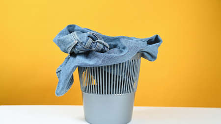 clothes are thrown in the trash. High quality photo