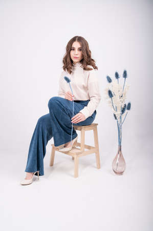 Stylish caucasian woman wear casual suit, blouse and trousers. Spring summer fashion trend. Fashion outfit. High quality photo