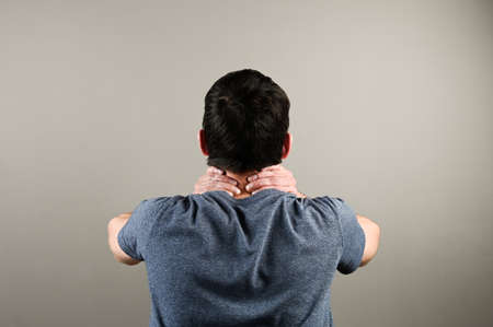 Rear view of man with neck pain. Health problem at office work. High quality photo 版權商用圖片