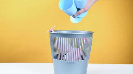 Throw colored plastic in the trash bin. High quality photo 版權商用圖片