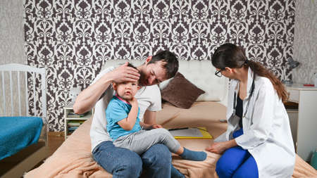 the child has a fever, a doctor's visit at home. High quality photo