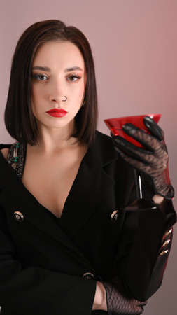 Beautiful girl with a red glass