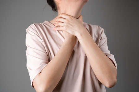 Woman has a sore throat. 版權商用圖片