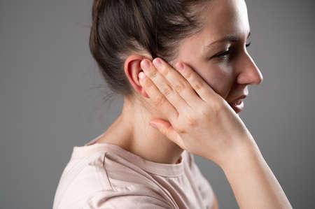 The woman has a sore ear. Reklamní fotografie