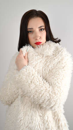 Winter fashion woman in luxurious fur coat. Beauty Fashion Model Girl. Beautiful winter girl Reklamní fotografie