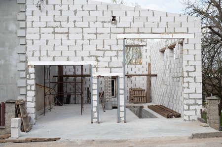 Construction of a garage from foam blocks. for cars and trucks Reklamní fotografie