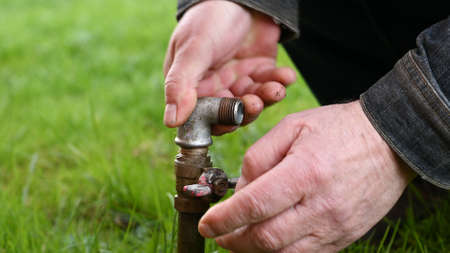 Water pipe for hose in grass.