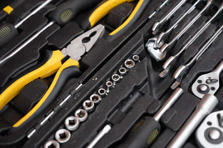 A set of black and yellow tools.