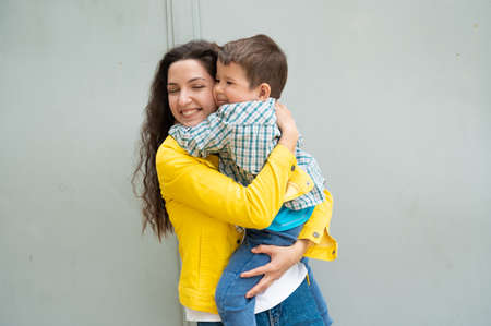 Young happy mom holding baby in her arms.