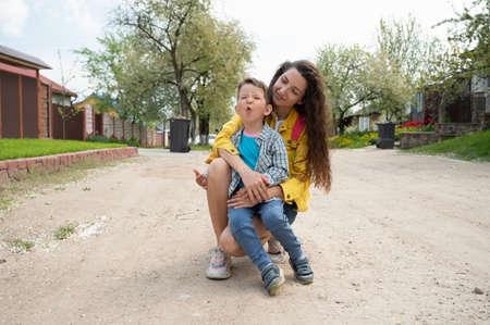 Cheerful mother hugs the child. 版權商用圖片