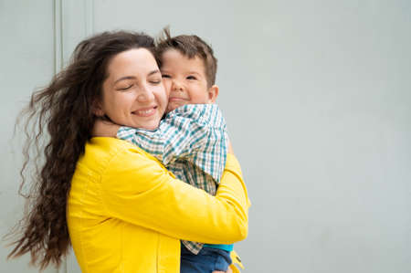 Young mother hugs the baby in her arms.