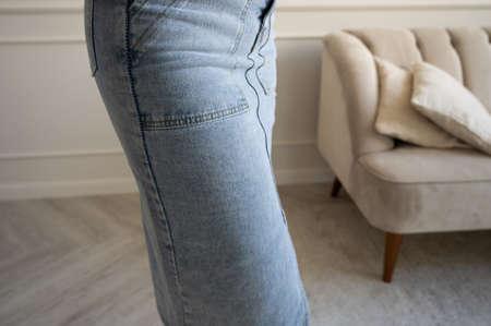 Woman in long denim skirt Archivio Fotografico