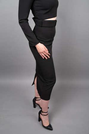 Woman showing long black skirt. 版權商用圖片