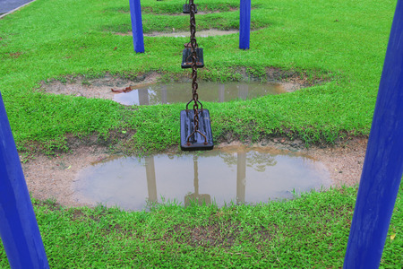 chain swing ride: Swing on a rainy day Stock Photo