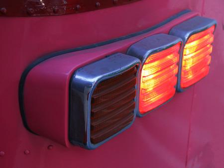 headlight: Headlight of the red car Stock Photo