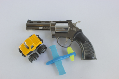 gripping: Pistol Revolver Handgun Isolated On White Background. car and a plane. Stock Photo