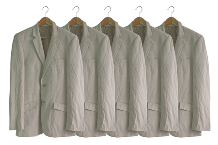 folded clothes: men suit isolated on white.