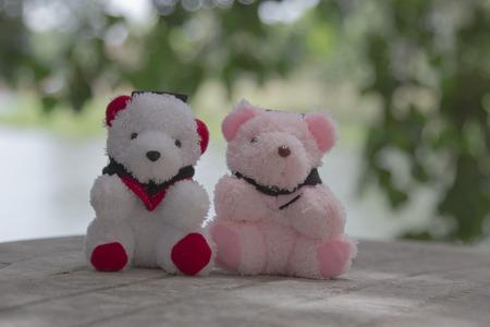 cuddly baby: Toy teddy bear Background bokeh
