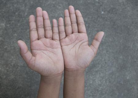 upturned: Upturned hands on sidewalk background