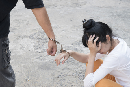 A man and womans hands are handcuffed together. no freedom Stock Photo