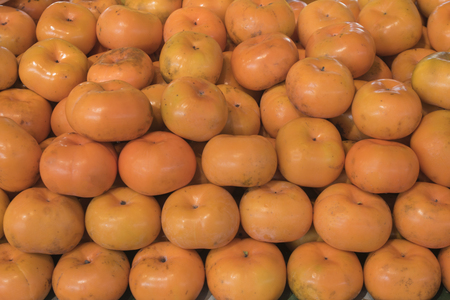 Persimmon sweet summer fruit faw fresh food Stock Photo