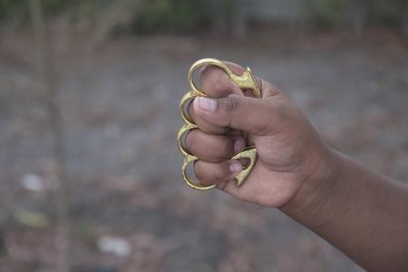 knuckles: Hand man wearing brass knuckles