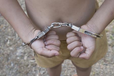 boy hands in handcuffs. no freedom