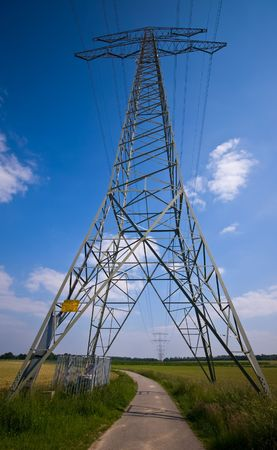 high voltage power tower in a rural scene