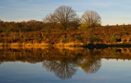 color full autumn scene in the late afternoon with reflection in the lake   photo